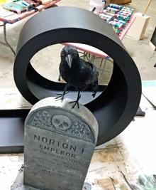 A raven sitting on a tombstone